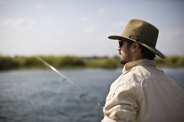 Mid-adult man fishing.