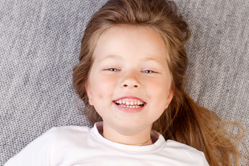 Portrait of the beauyiful smiling little girl
