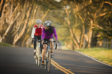 Mature woman and older man out cycling together