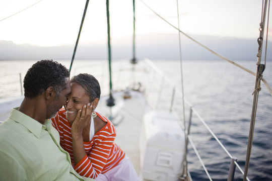 Couple relaxing on a yacht.