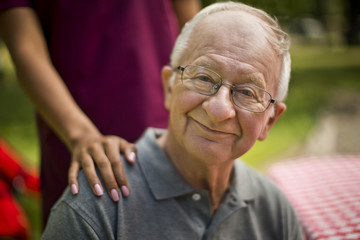 Portrait of a happy senior man at a picnic.