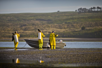 Group of fisherman preparing to go out in their boat.