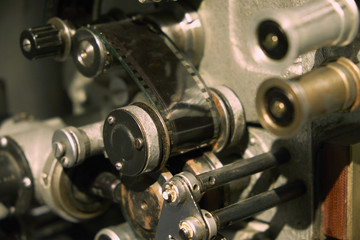 Retro film projection machine with film closeup photo