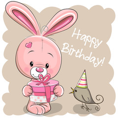 Cute Rabbit with gift on a beige background