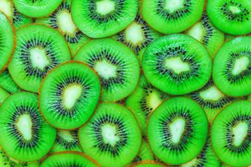background of colorful fresh pieces of fruit kiwi