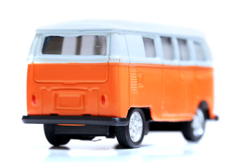 Small dicast car model on white background