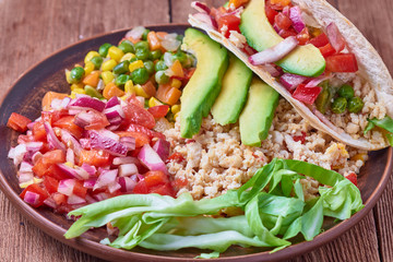 Traditional Mexican food is tacos with meat and vegetables. Fresh cabbage, avocado, pepper, onion, corn, tomatoes.