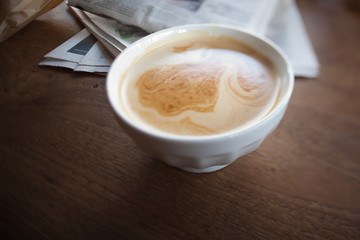 Cafe au lait and newspaper