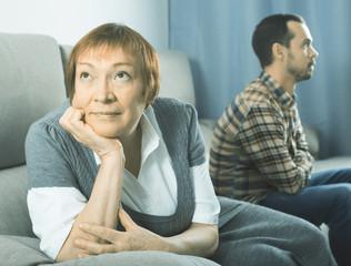 Elderly mother and son quarrel