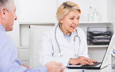 Doctor listens to mature patient