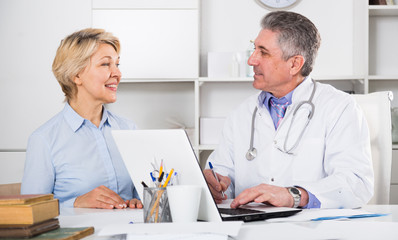 Mature woman visits doctor