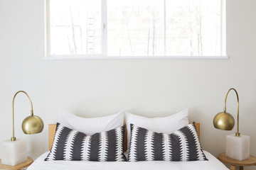 Bed detail with black and white patterned pillows