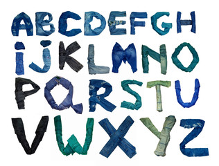 the English alphabet is laid out from letters consisting of jeans clothes of various shade