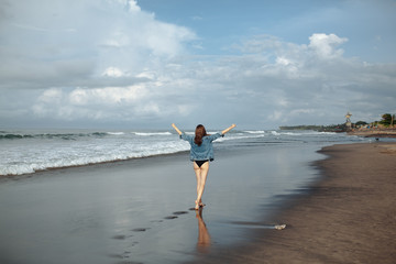 freedom and happiness woman walking on beach,enjoying ocean during travel
