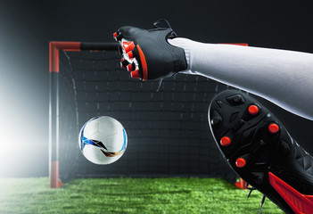 Soccer football kick striker scoring goal with accurate shot