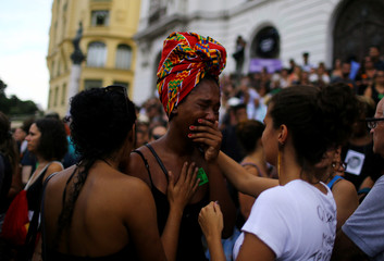 Mourners react outside the city council chamber ahead of the wake of Rio de Janeiro's city councillor Marielle Franco, 38, who was shot dead, in Rio de Janeiro