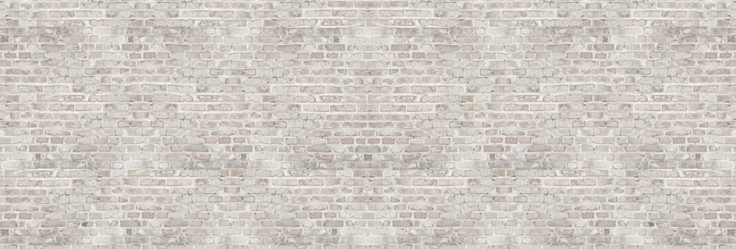 Vintage white wash brick wall texture for design. Panoramic background for your text or image.