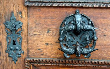 Old lock and handle of the door in Prague castle, Czech Republic