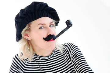 portrait of blond woman as french man with beret, mustache and pipe