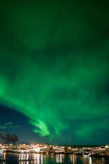 Northern lights over the vilage of Reine, Lofoten, Norway