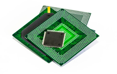 Computer electronic chips isolated on white arranged in a stack. The chips are placed upside down or facing the viewer. there are different chips in the stack