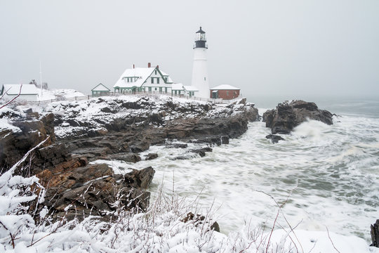 Portland Head Lighthouse covered in snow following a beautiful storm.