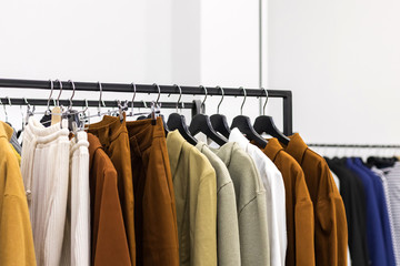 Fashion luxury elegance clothes on the display shop. Fast fashion, mindfulness consumering