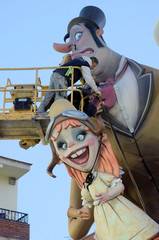 Craftsmen put the finishing touches on a monument at the start of the Fallas festival in Valencia