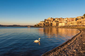 Anguillara Sabazia, Italy - The Bracciano lake at sunset from the old stone town on the waterfront named Anguillara Sabazia, province