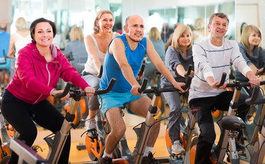 friends exercise in  fitness club