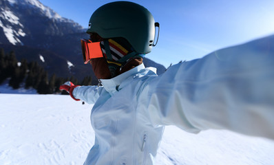 one snowboarder taking selfie on winter mountain top