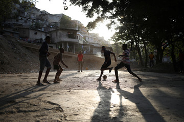 Children play football in Port-au-Prince
