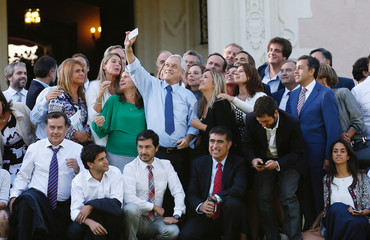 Chile's President Sebastian Pinera takes a selfie next to his ministers and parliamentarians after a working meeting at the presidential palace of Cerro Castillo at  Vina del Mar.