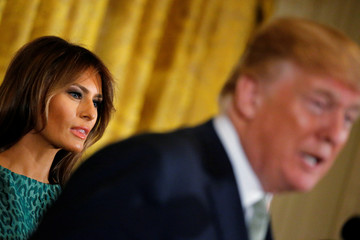U.S. first lady Melania Trump looks on as President Donald Trump plays host to Ireland's Prime Minister, Taoiseach Leo Varadkar during a St. Patrick's Day reception at the White House