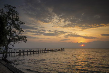 sunset and pier in kep on cambodia coast