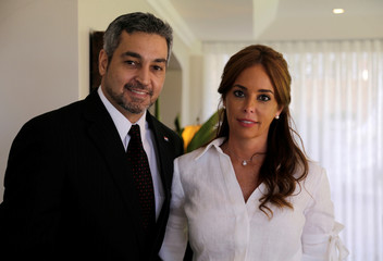 Presidential candidate Mario Abdo Benitez of the Colorado Party and his wife Silvana Lopez Moreira pose for a photograph during an interview with Reuters, in Asuncion