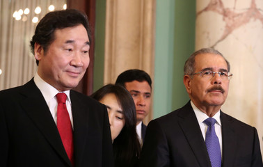South Korea's PM Lee stands with Dominican Republic President Medina at the national palace in Santo Domingo