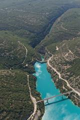 Aerial image showing the Lac de Sainte-Croix with the bridge Pont de Sainte-Croix and Barrage de Sainte-Croix and behind it the Gorges du Verdon