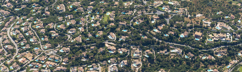 Aerial image of an abundancy of private swimming pools at these villas in Sainte-Maxime