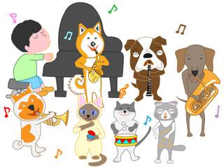 猫と犬のコンサート。子供とペットが歌ったり、楽器を演奏したりしている。