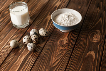 Baking ingredients for homemade pastry on dark rustic wooden background. culinary concept Copy space