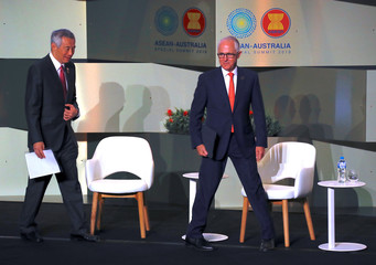 Australian Prime Minister Malcolm Turnbull arrives with Prime Minister of Singapore Lee Hsien Loong at the start of the SME conference being held during the one-off summit of ASEAN in Sydney