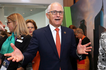 Australian Prime Minister Malcolm Turnbull reacts as he walks near delegates during a Marketplace walkthrough as part of the SME conference during the one-off summit ASEAN summit in Sydney