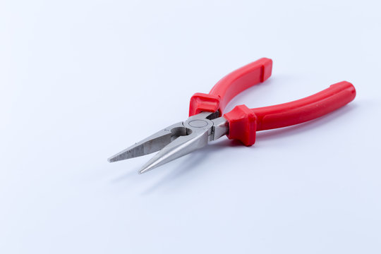Red Needle Nose Pliers also known as pointy nose pliers or long nose pliers isolated on white background.
