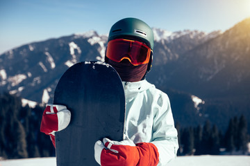 one snowboarder with snowboard on winter mountain top