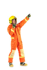 Firefighter in uniform and safety helmet standing full body length