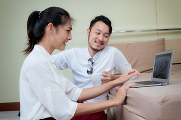 Happy couple using laptop to shopping online