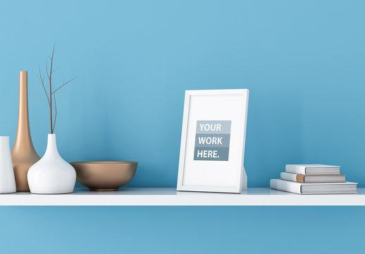 White Photo Frame Mockup with Bright Blue Background