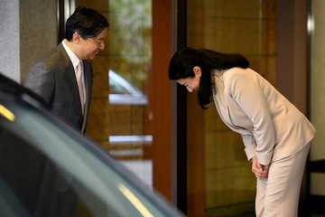 Japanese Crown Princess Masako bows to Crown Prince Naruhito at the entrance of Togu Palace as Crown Prince departs for Brazil in Tokyo