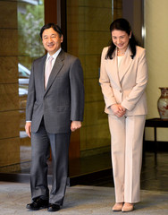Japanese Crown Prince Naruhito and Crown Princess Masako walk out to the entrance of Togu Palace as the Crown Prince departs for Brazil in Tokyo, Japan